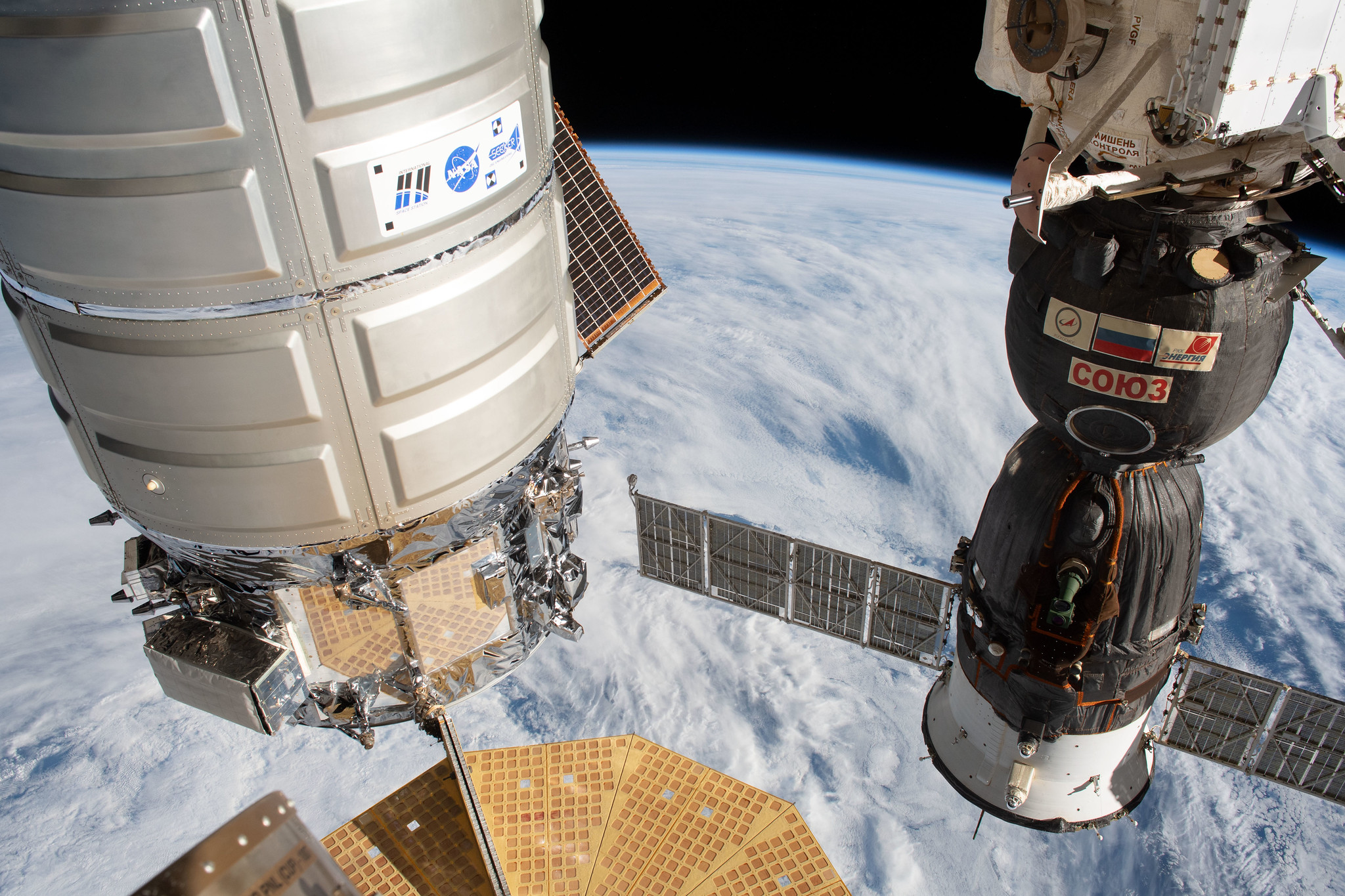 The NG-11 Cygnus, left, is attached to the space station's Unity module. Credit: NASA