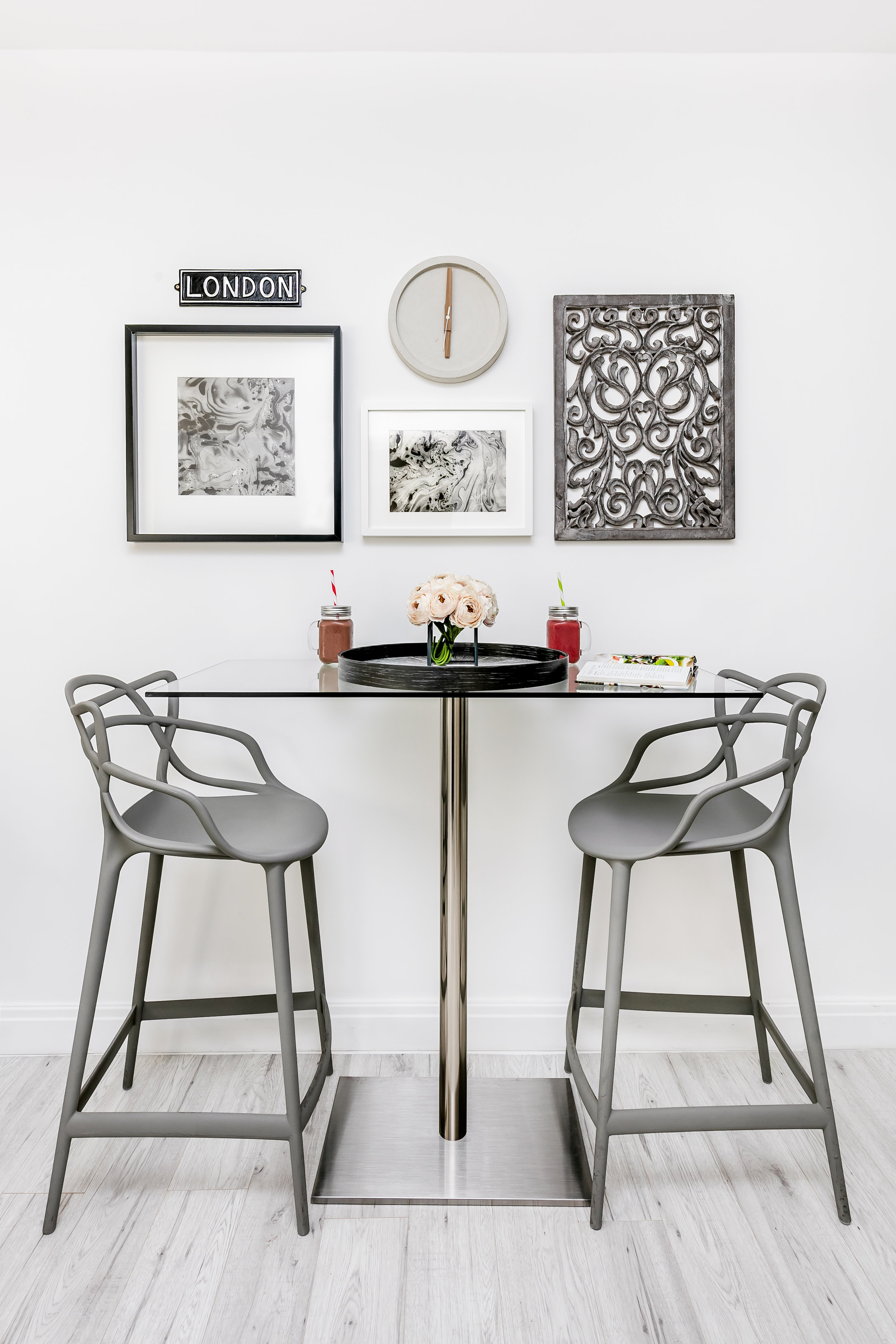 TIP  - Arranging wall hangings around the Breakfast Bar focuses the space.