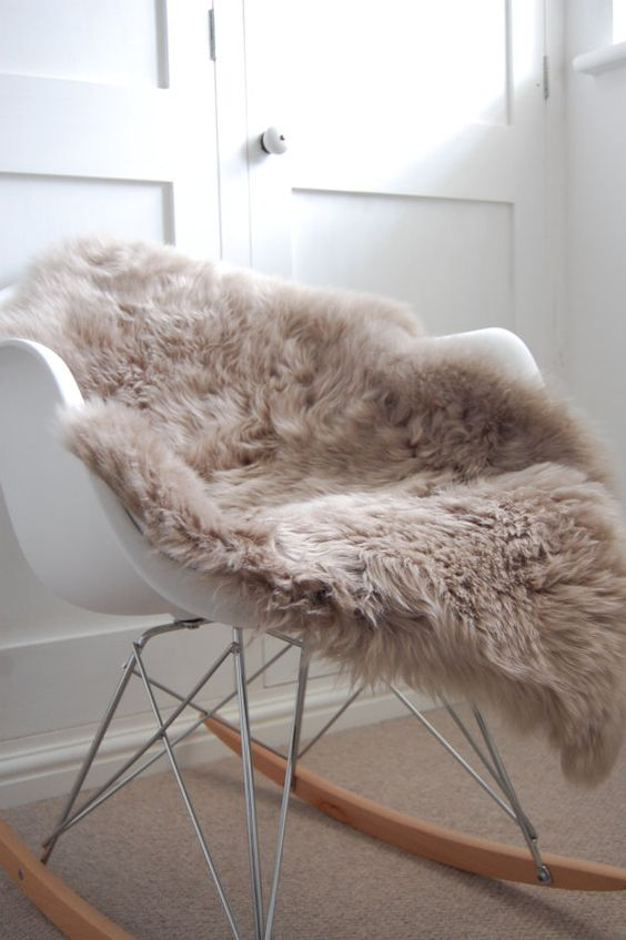 A taupe sheepskin rug or throw will introduce enough warmth to your muted interior tones.