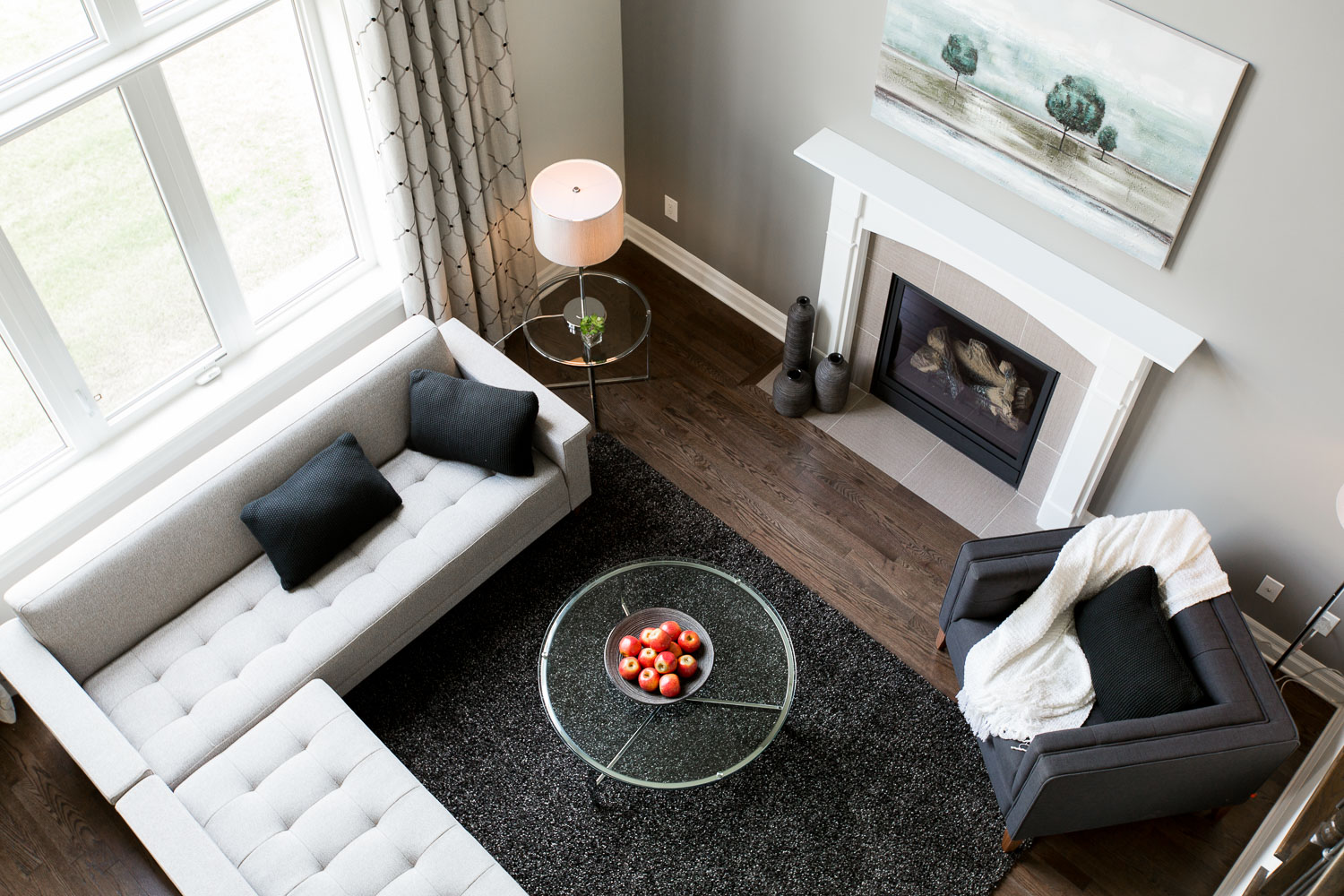 Photograph of a living room with a fireplace