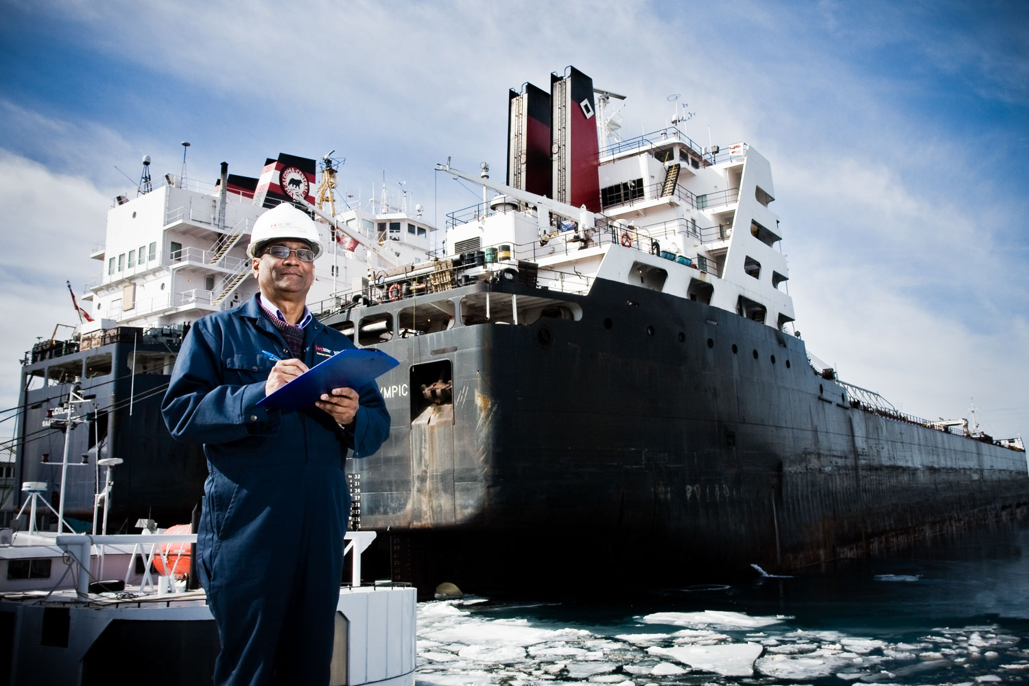 Portrait of a worker in front of a ship