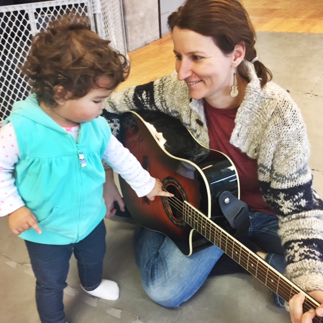London playing the guitar with Lenka, our Music Together teacher!