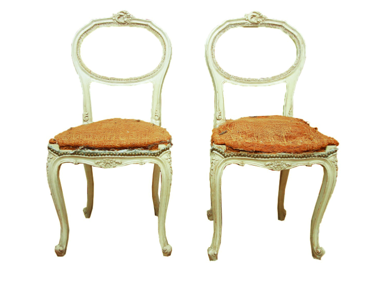 A pair of Louis XV style balloon back chairs. These chairs features a balloon back with a carving to the top center that connects to the rounded seat with nailhead trim. The seat rises above cabriole legs terminating on scroll feet. They have jute weaving to the underside.