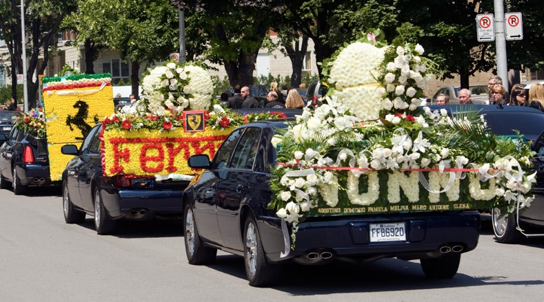 Cars covered in flowers for the procession after funeral services for  Agostino Contrera