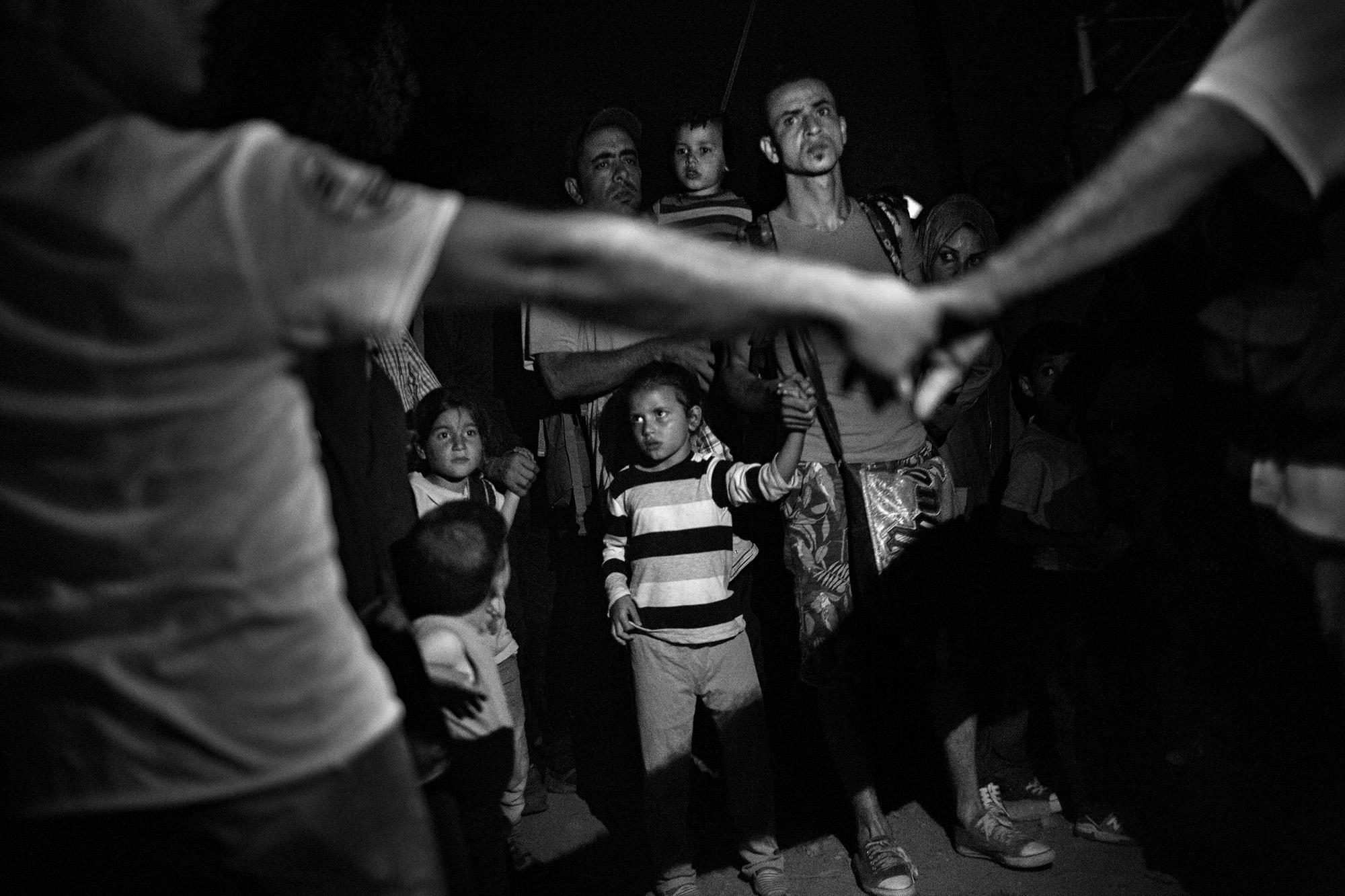 Idomeni, Greece - Syrian refugees waiting to cross an illegal border between Greece and Macedonia near Idomeni, Greece.