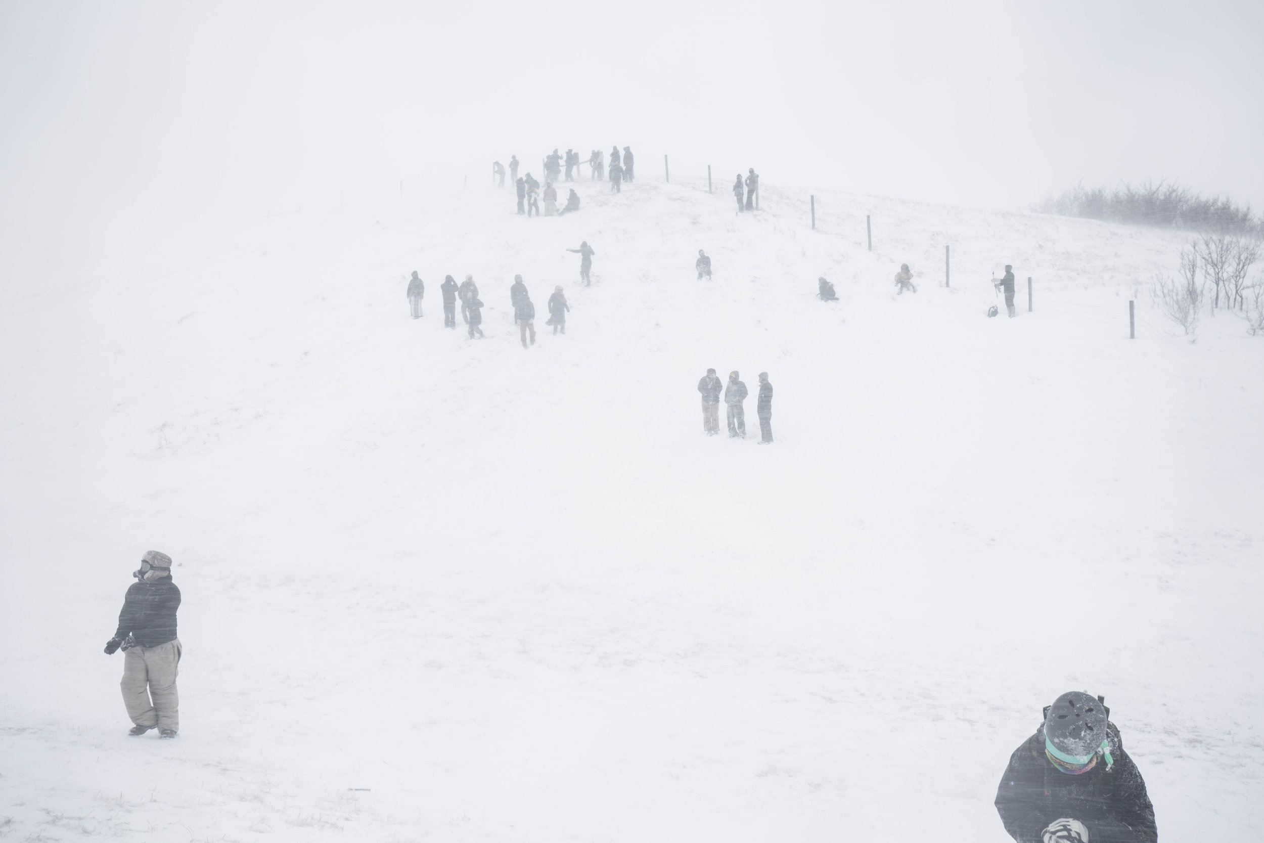 Water Protectors and veterans gather on a hill along highway 1806 on December 5, 2016 during blizzard that left hundreds if not thousands stranded in the nearby tribal casino resort.