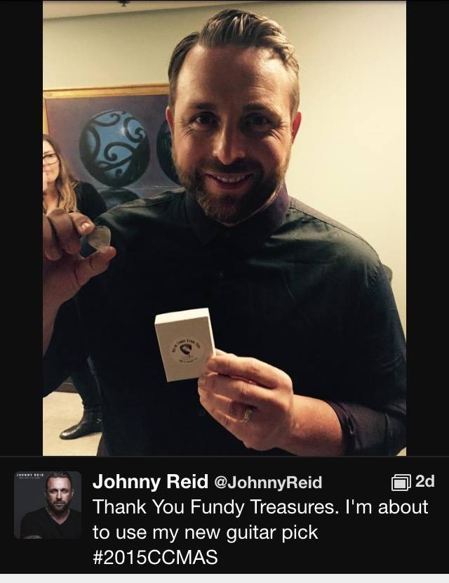 Johnny Reid giving a shout out to Fundy Treasures for the amazing Nova Scotia made guitar pick he used in his CCMA stage performance.  Very cool!