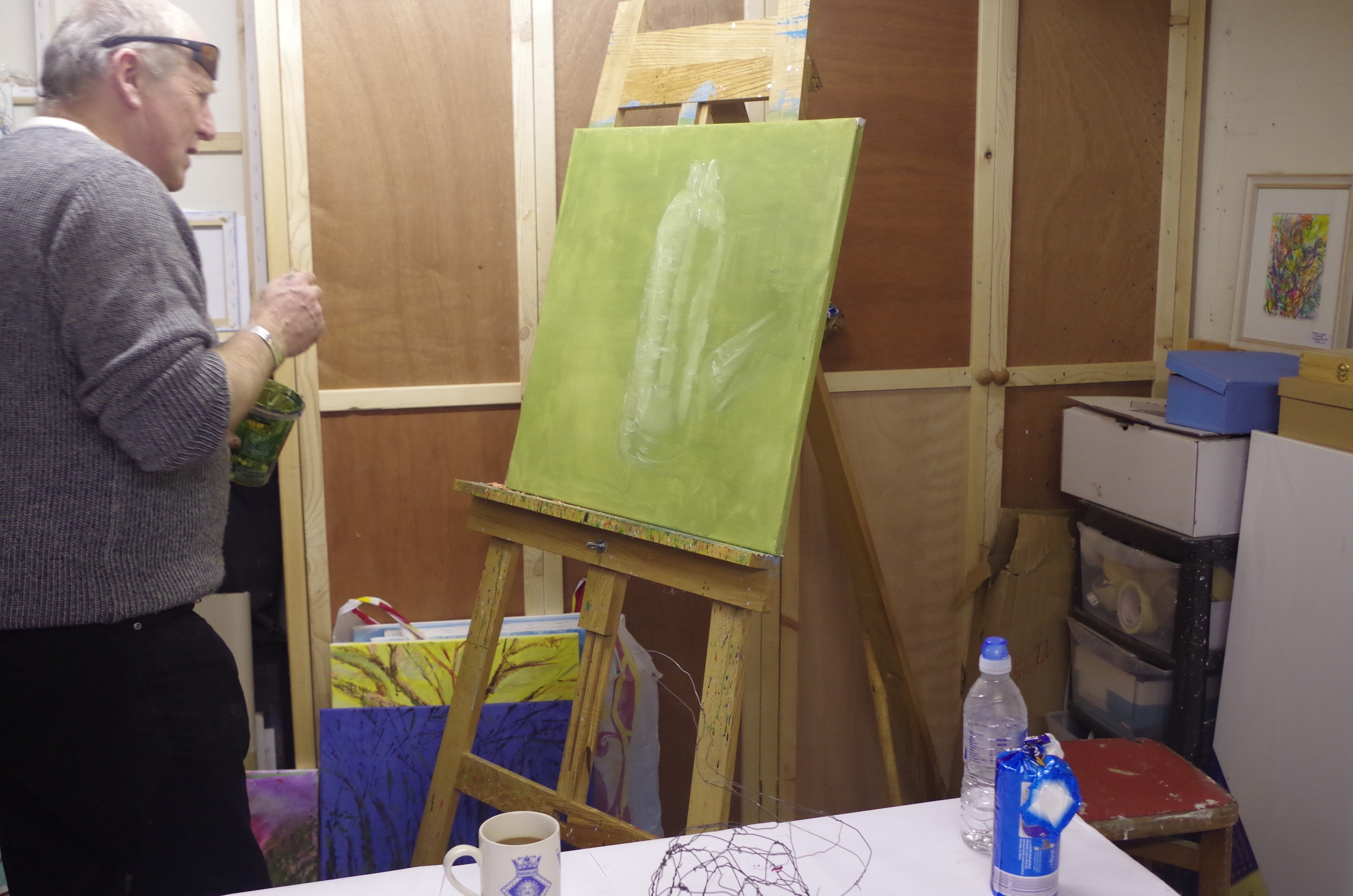 A regular 1-2-1 tuition client in the throws of a creative painting challenge!