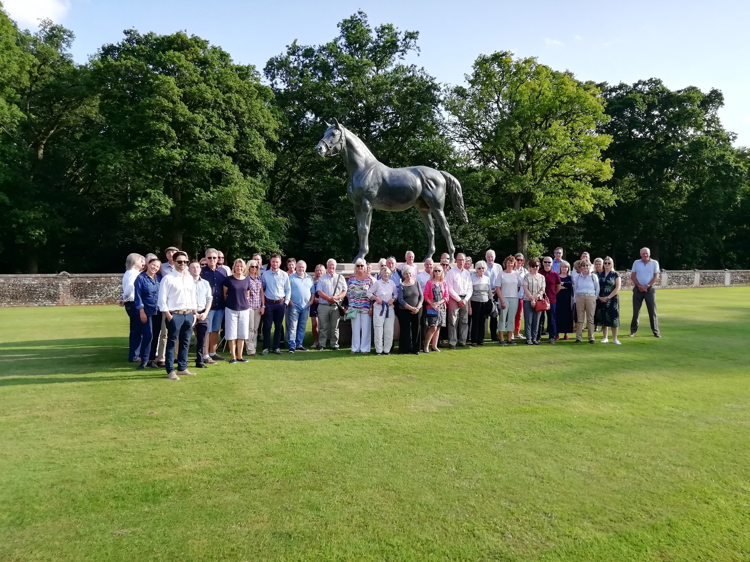 The stud visitors standing in front of Persimmon, winner of the Derby in 1896, owned by the Prince of Wales.