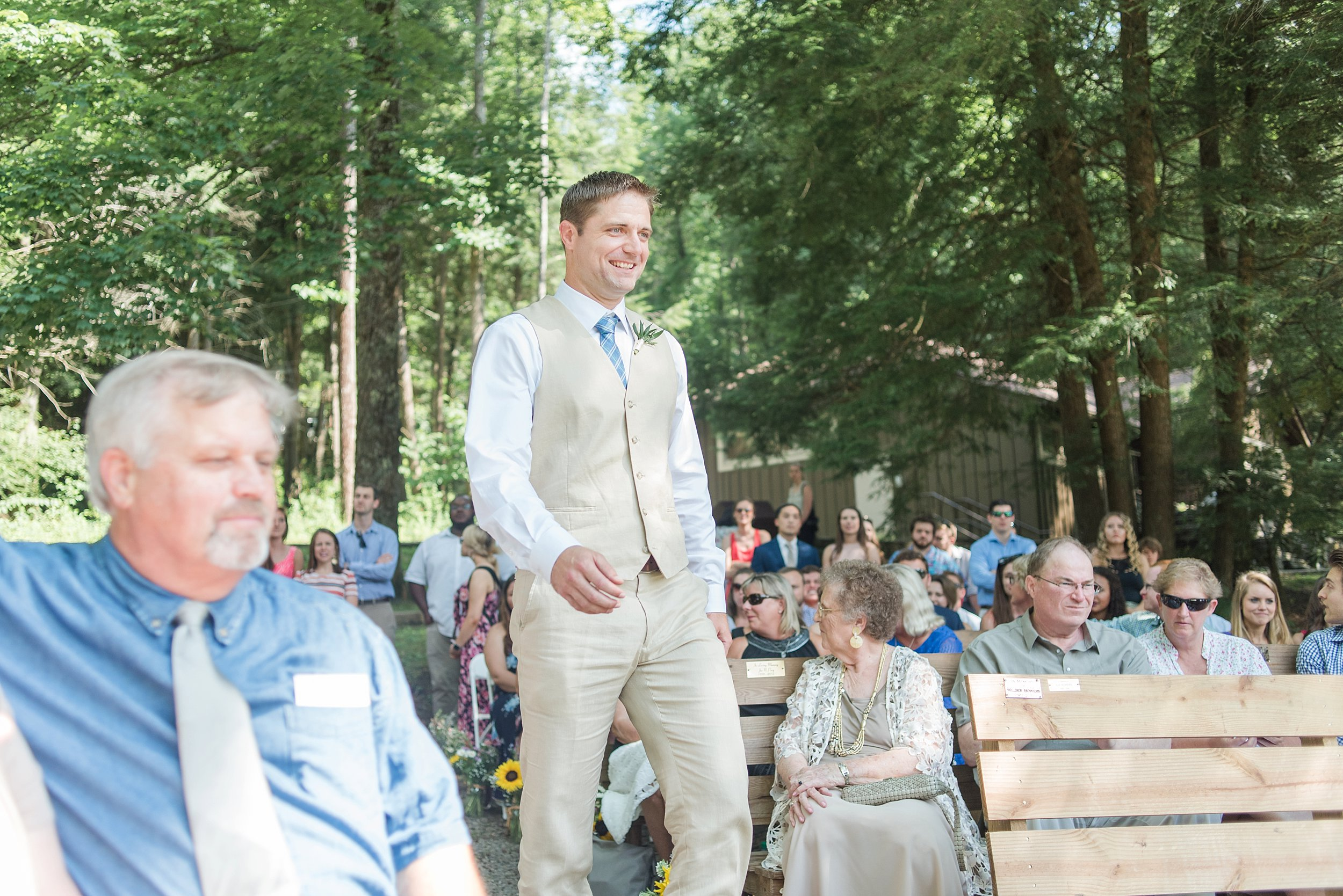 I loved that during the ceremony, the officiant had Ethan stand faced away until right when Becky walked down. That way when she was just in the right place, she was perfectly in view for when he first saw her.