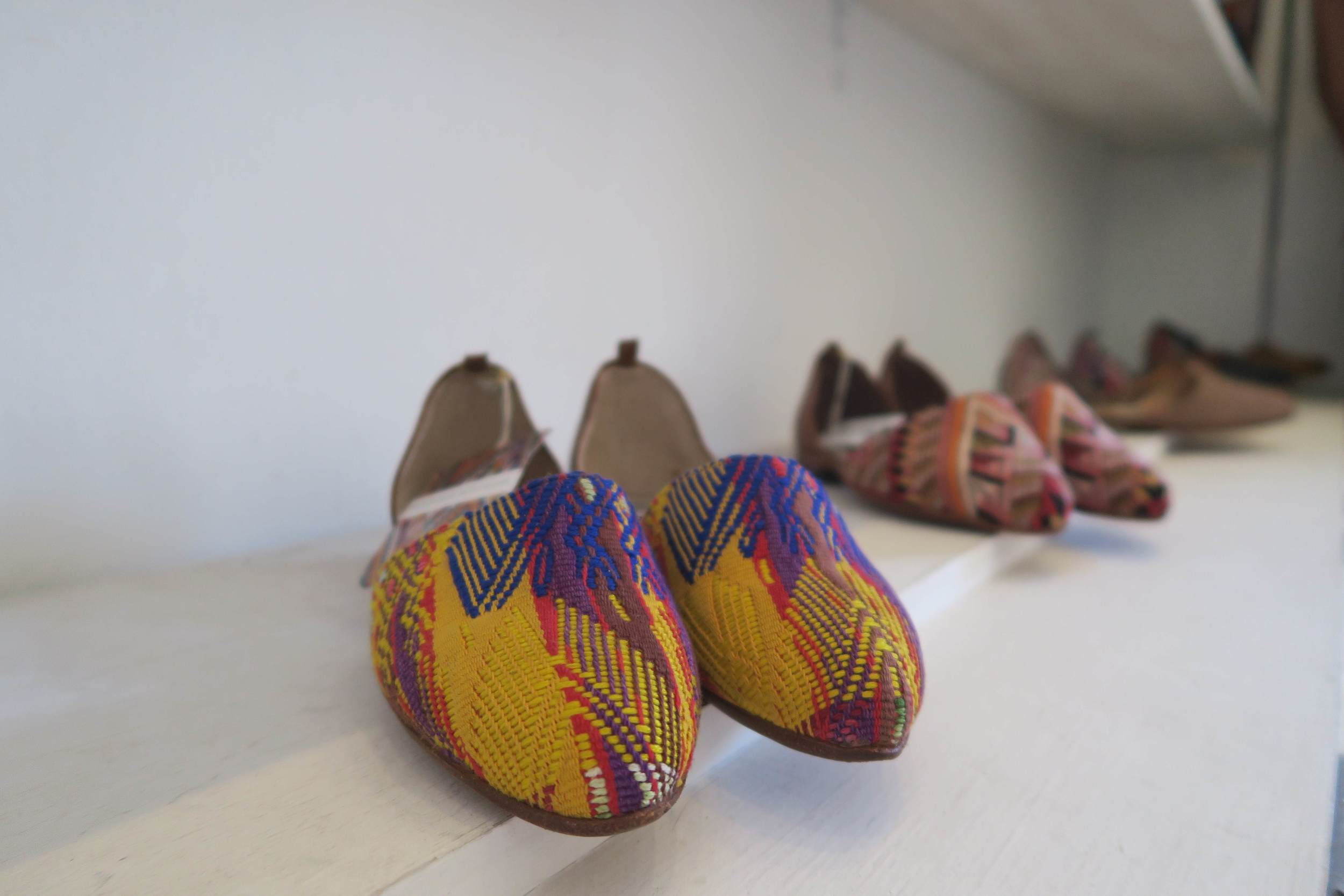 Shoes made using traditional Maya fabrics, at Uxibal in Antigua.