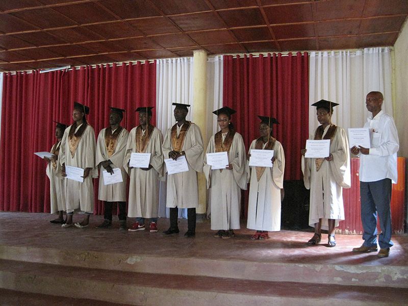 Our graduates! (The man at the far right is receiving the certificate in place of one of the graduates who was traveling in Kenya and unable to attend the celebration.)