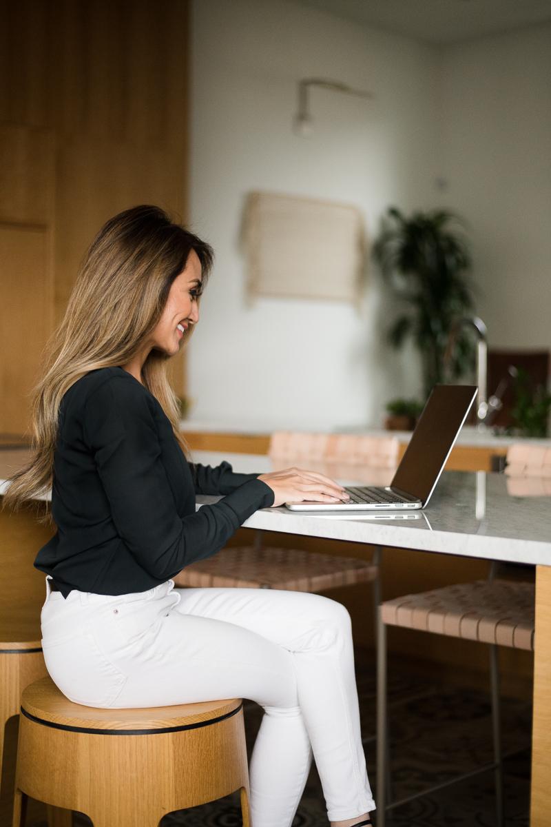 Denver real estate headshot photographer at a computer