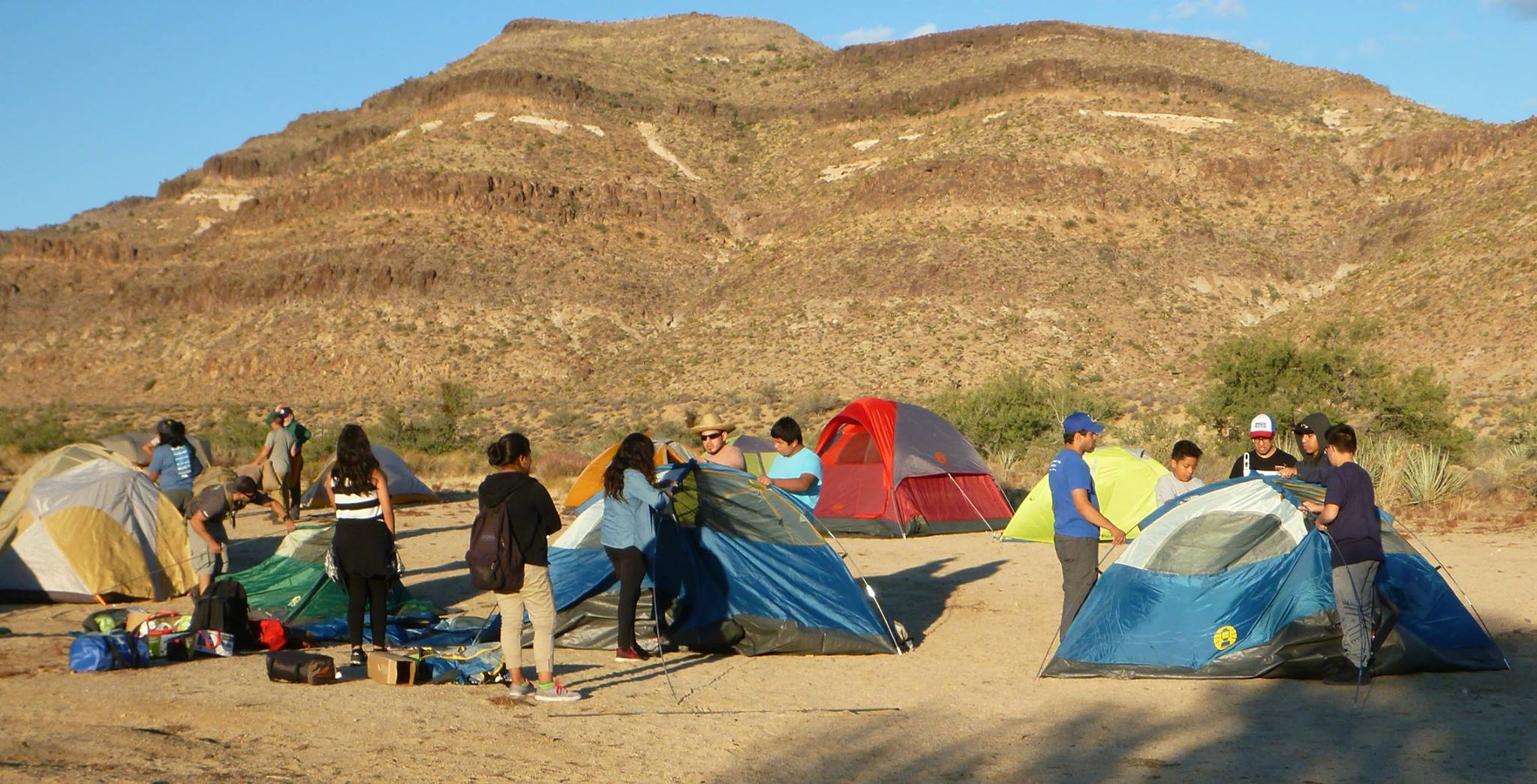 Youth setting up their tents at the Black Canyon Group Campground in the Preserve.