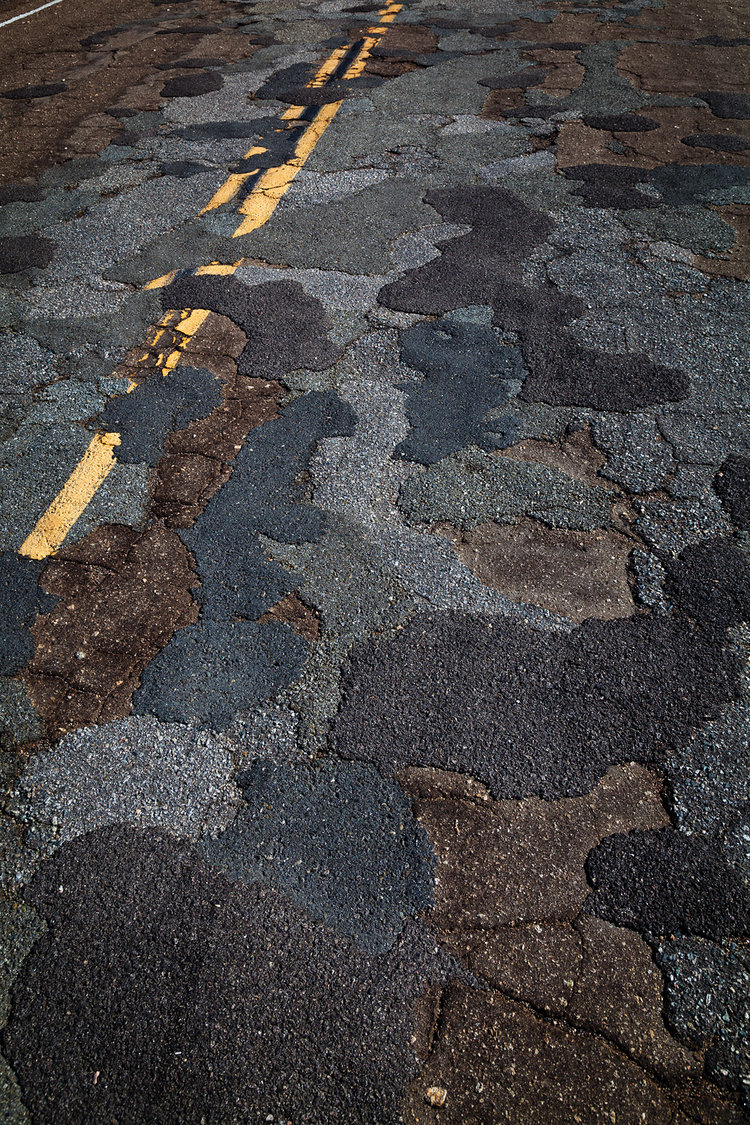 The maintenance backlog affects roads and facilities in the Mojave National Preserve, one of over 400 national park sites. This photo by Michael Gordon shows the affect of deferred maintenance on Cima Road in the Mojave National Preserve.