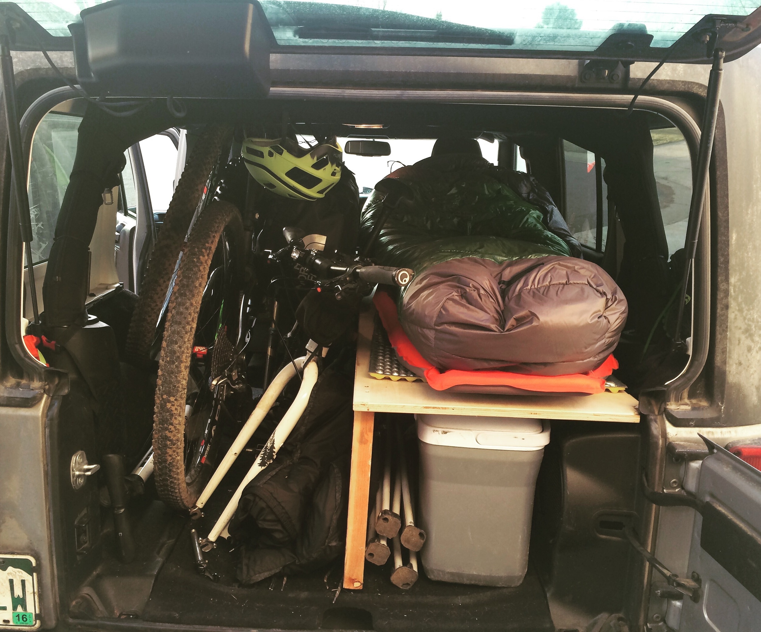 "Current camp situation in my Jeep Wrangler Unlimited. I'm 6'2"" so it's a tight squeeze but it's still so much fun."