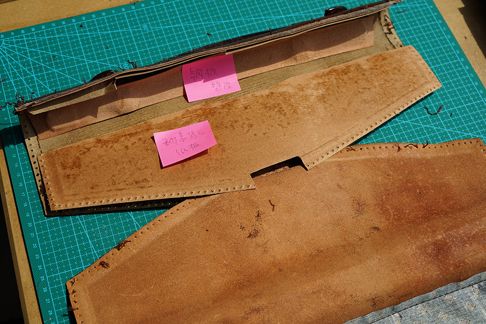 The flap is constructed with 4 layers: leather, card paper, stronger card paper, leather.