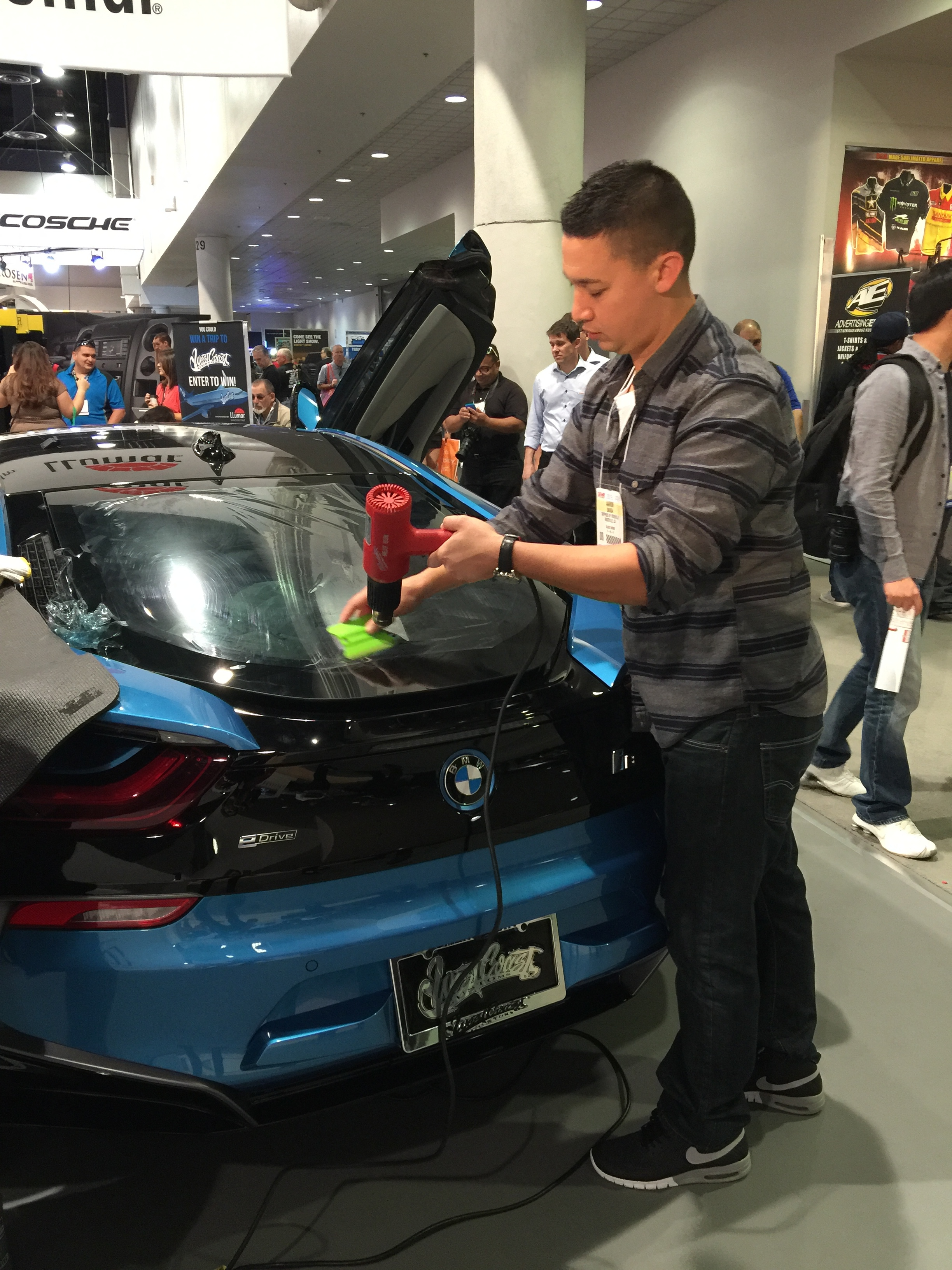Aaron performing tint demonstrations at the 2015 SEMA Show