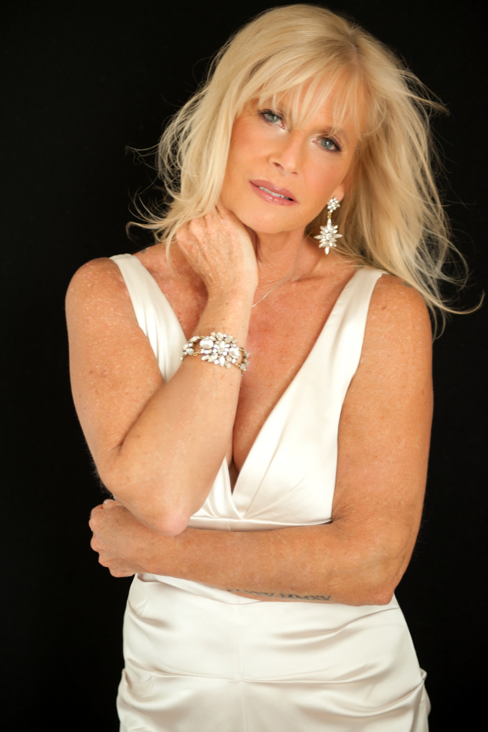 I'm 57 years old and up until now I have never had a photo session like this one. Professional hair and makeup were done first by the lovely Shannon. She kept it light and natural as I requested. Dawn was a darling, posing me in ways to get the best shot. It was a comfortable environment which I embraced, feeling like a glamorous woman. The hardest part of it was trying to choose from all the photos. I loved them all. I would recommend this for any woman as a gift or just to pamper and treat yourself... No matter what your age. I plan on going back for my 60th. Thank you ladies. It was a remarkable experience.
