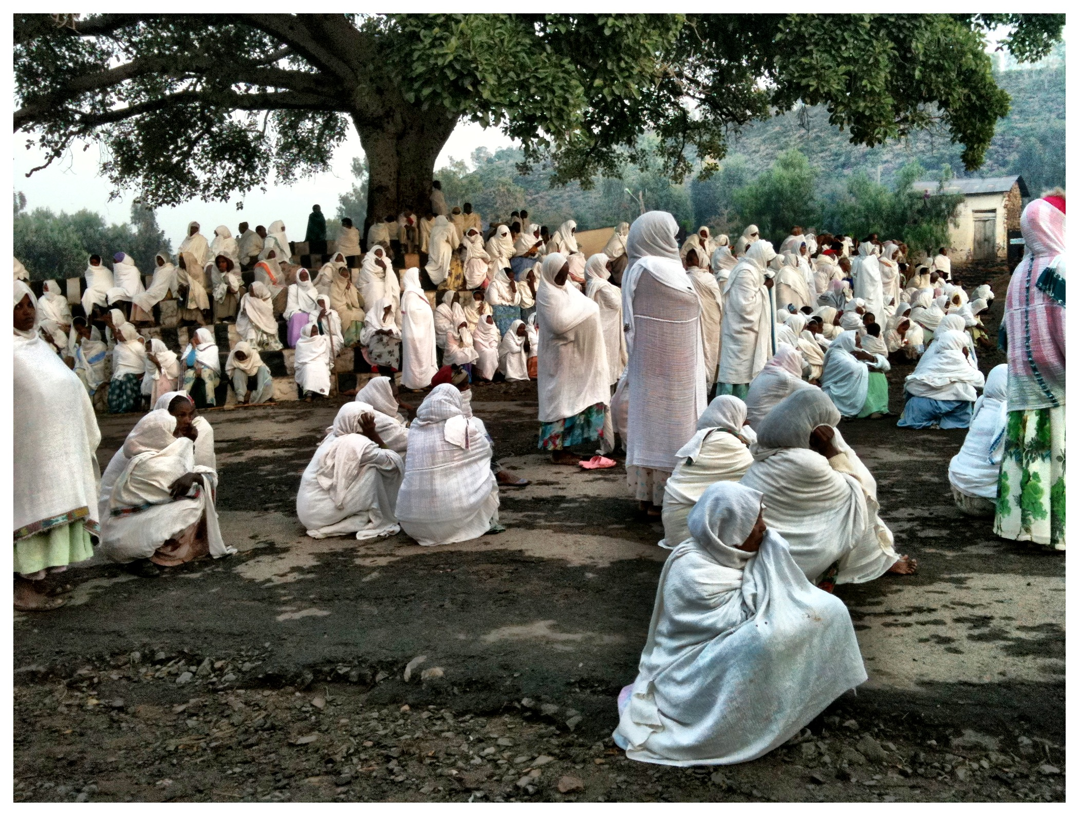 Early worship outside the Church of Our Lady Mary of Zion, Axum. This most important church in Ethiopia claims to contain the Ark of the Covenant.