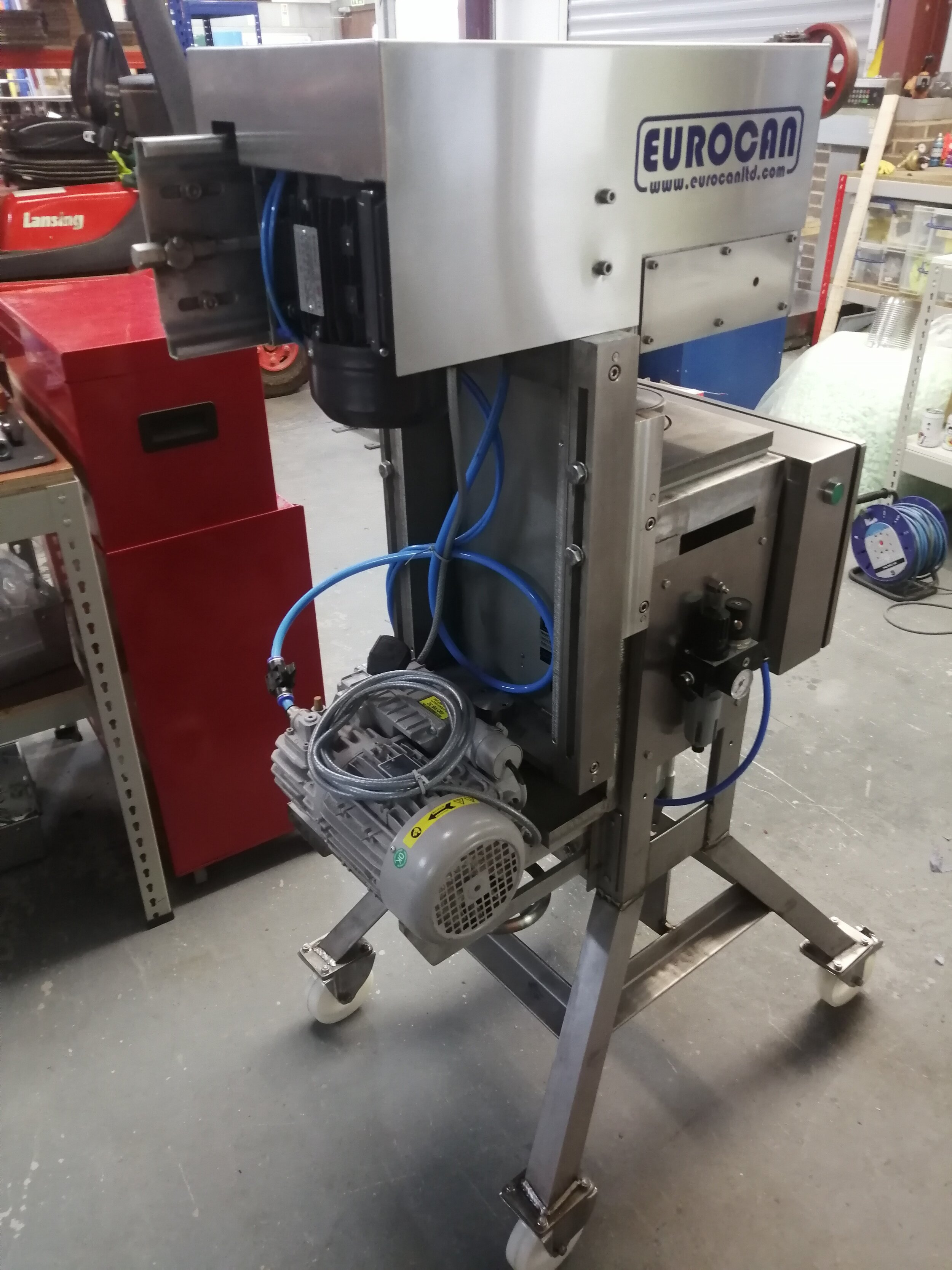 June 2019 - Our newly updated canning machines arrive at the bakery. We have two of these (one for each size of tin). Manufactured in stainless steel throughout. They are amazingly clever because they pull a vacuum on each tin. This removes the air from the tin and greatly enhances the shelf life of the cake. The vacuum pump is calibrated so that we can finely adjust the vacuum to exactly the right degree.