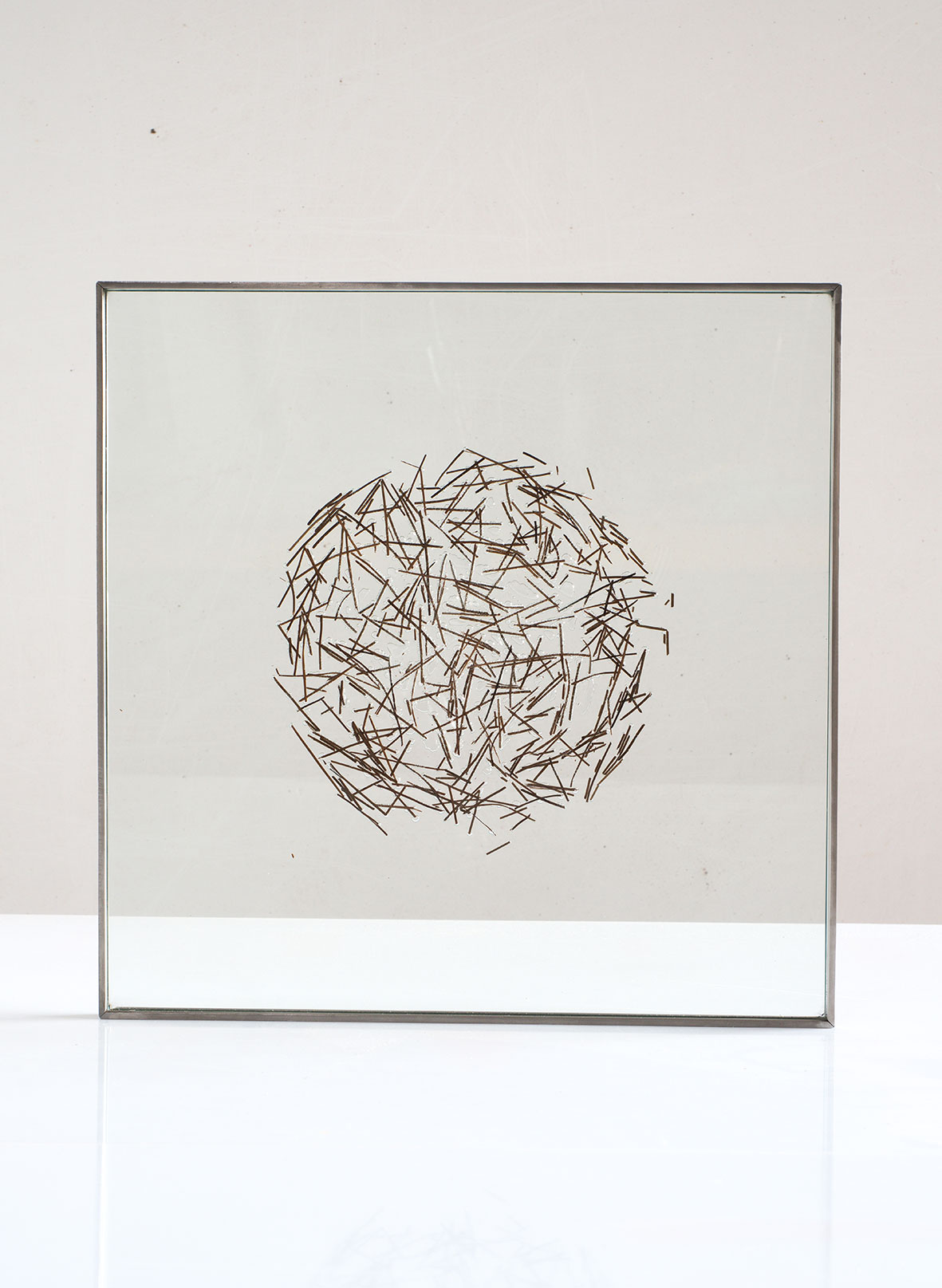 """Pine needles inserted in glass, 2015. 40cm x 40cm.(16""""x16"""")"""