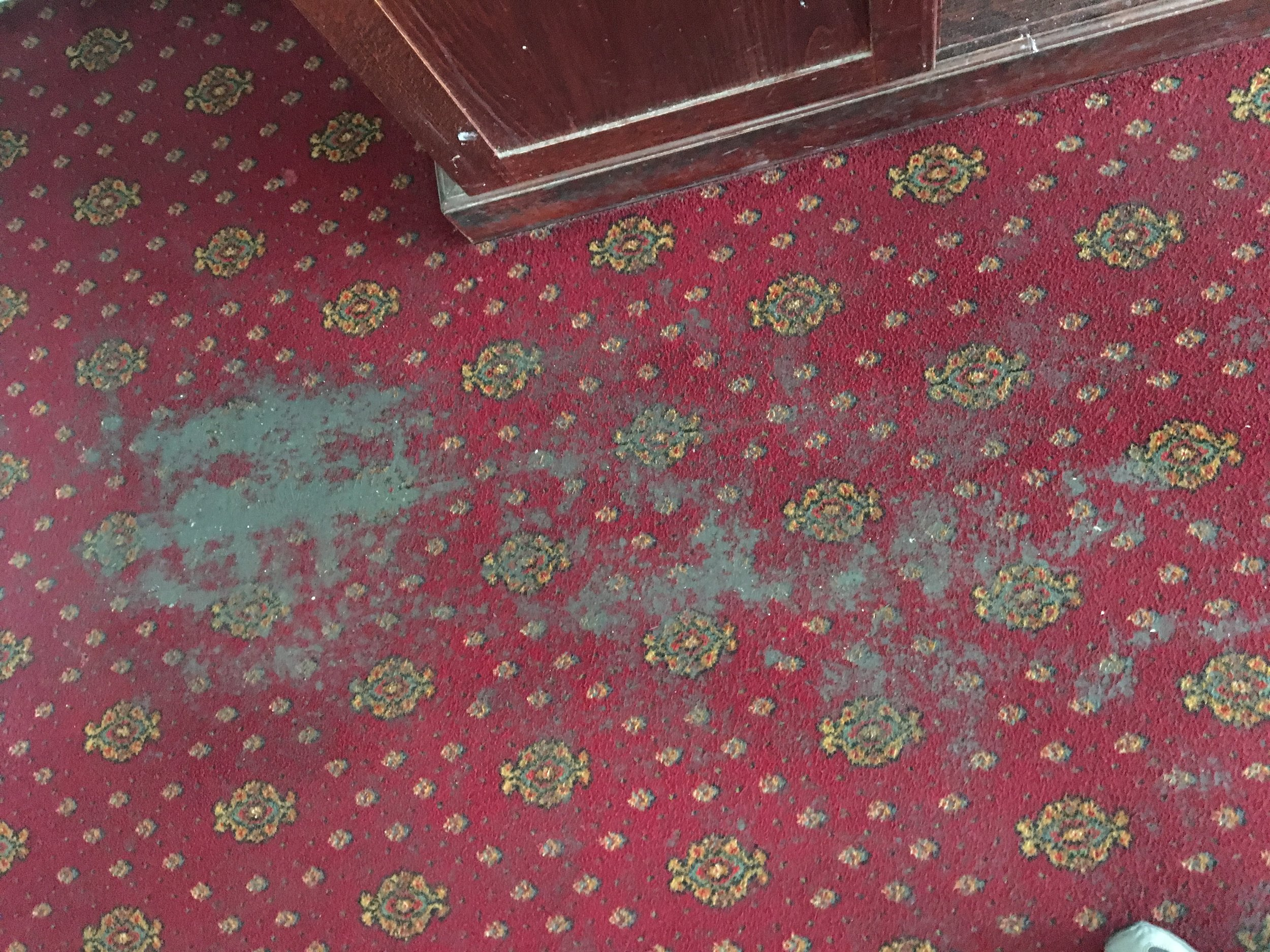 Grease and foodstuffs on a restaurant carpet