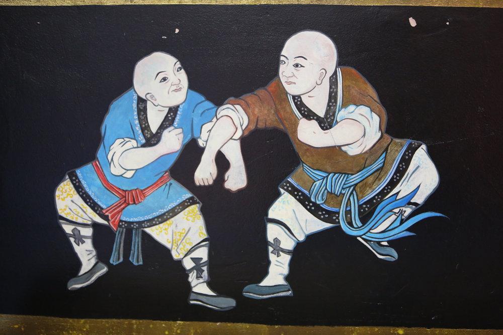 temple wall fighting monks2.JPG