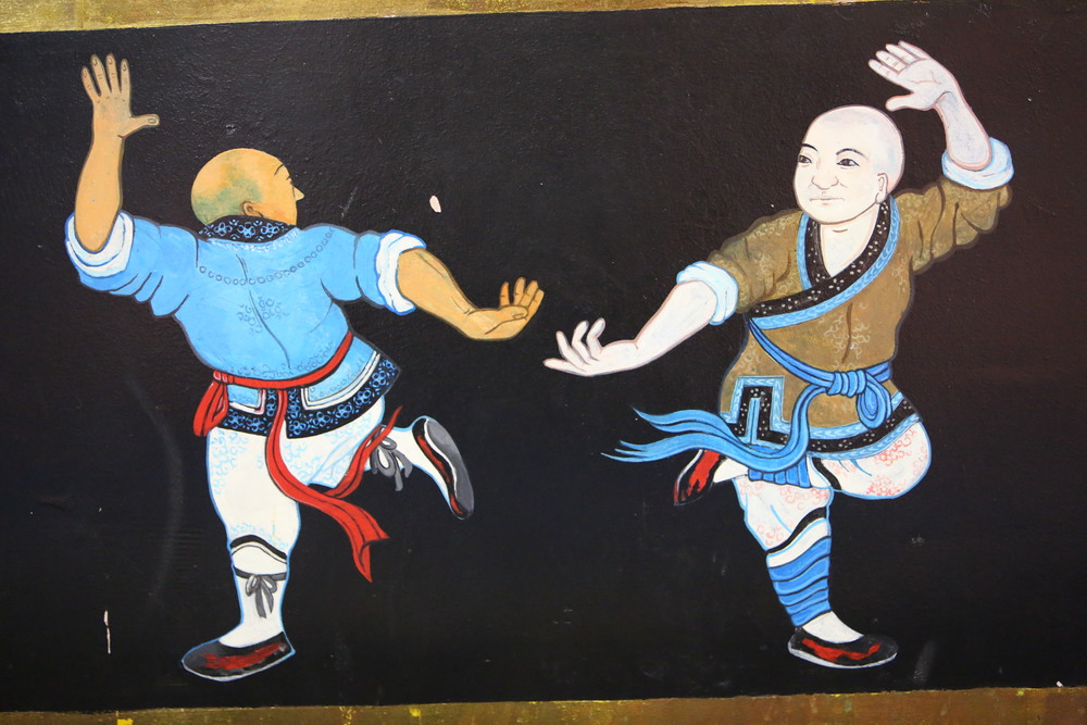 temple wall fighting monks1.JPG