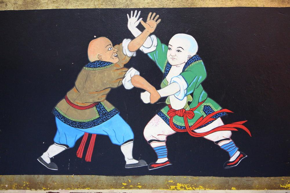 temple wall fighting monks3.JPG