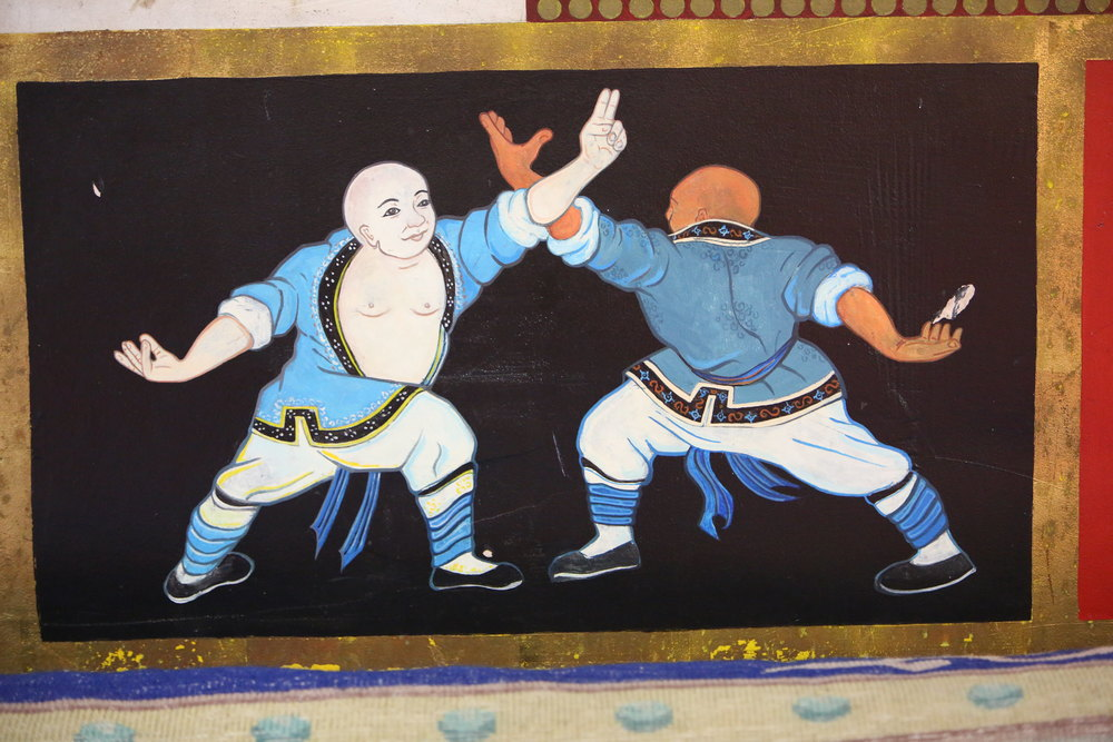 temple wall fighting monks4.JPG