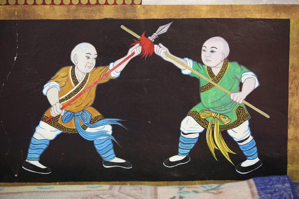 temple wall fighting monks5.JPG