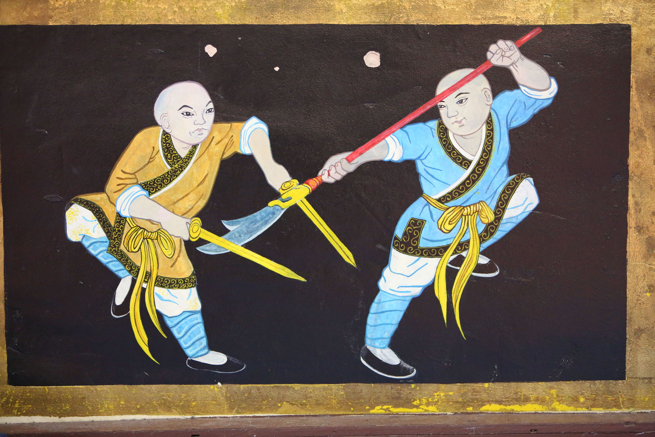 temple wall fighting monks6.JPG