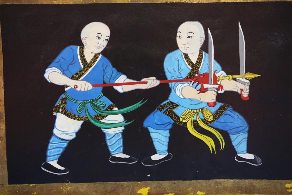 temple wall fighting monks7.JPG