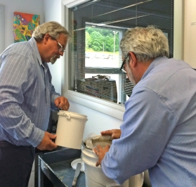 Ben Gavett and Mark Golden demonstrate a process of cleaning contaminated water.