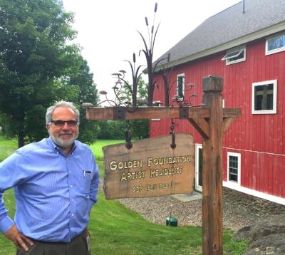 Mark in front of the Golden Foundation Artist Residence barn.
