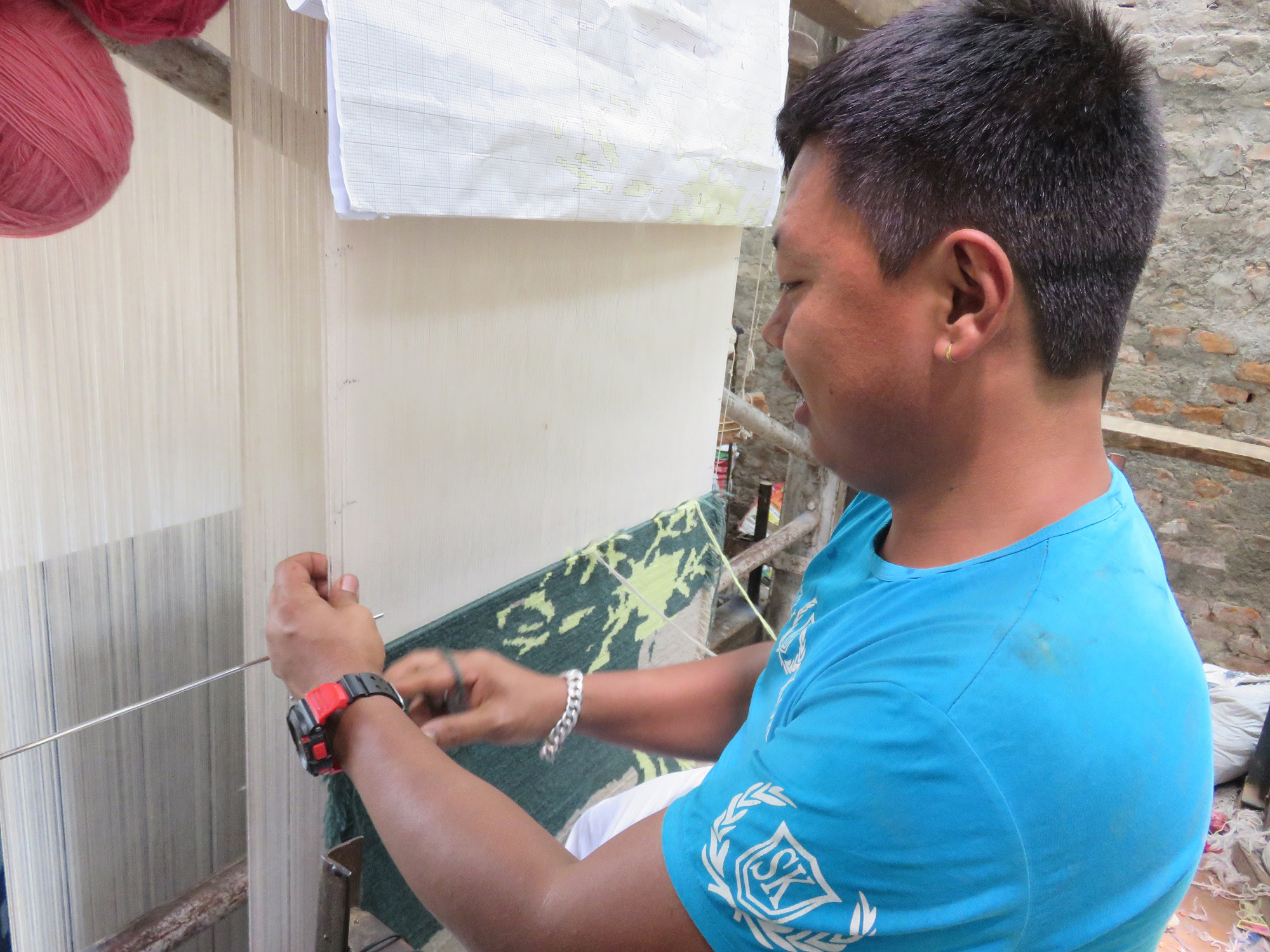 Rug weaver in Nepal for Gina Pierce