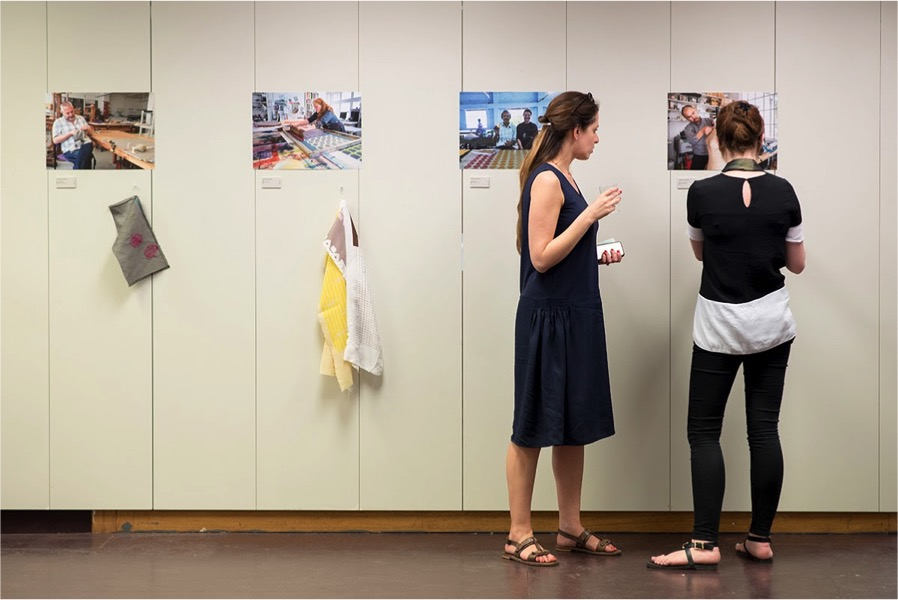 Photographs of the designers in their studios hung alongside a handling sample