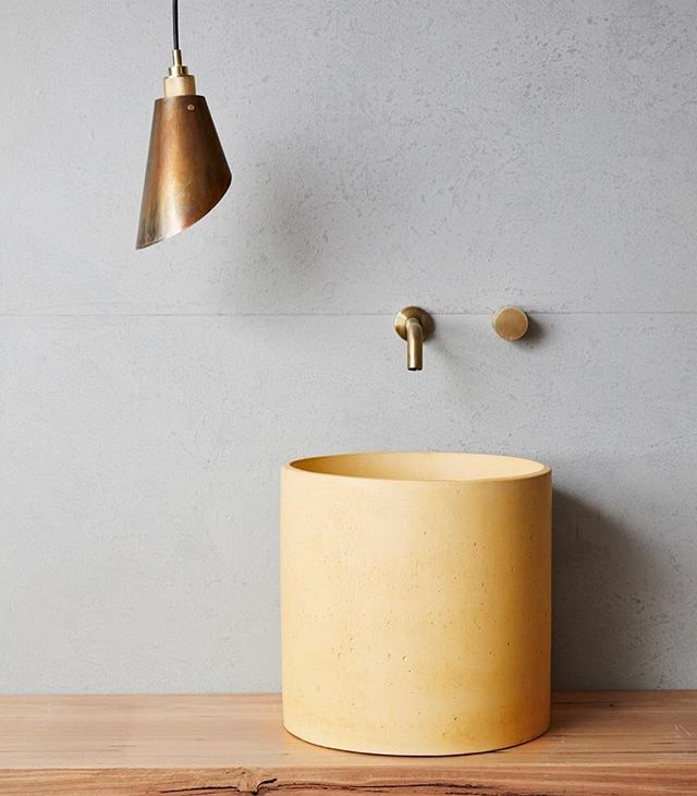 Our Too Tone pendant in burnished brass featured alongside @concretenation's Mini Column Basin in Pale Gold⠀ Tap ware: @abiinteriors ⠀ Blackbutt timber shelf: @goodwoodsupplyco ⠀ Photography: @jessiexprince ⠀ Lighting Supplied by: @threeballsred ⠀ ⠀ #repost #lighting #concrete #bathroom #sink #design #interiors  #interiorstyling #light #lightdesign #patina #brass