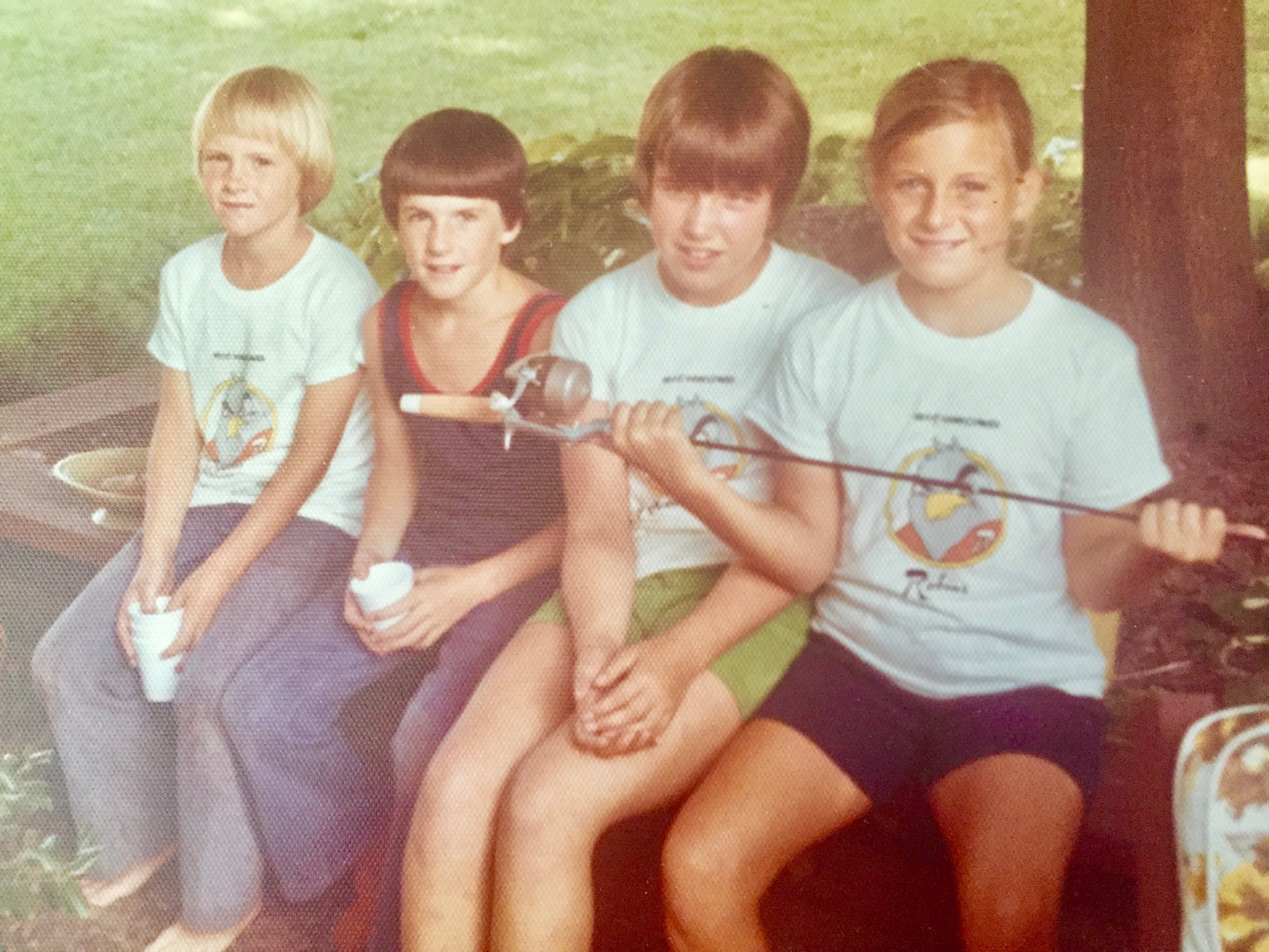 The summer of 1973 and cousins, plus one (left to right): cousin Dale & his buddy, cousin Debbie and me