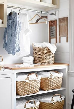 Baskets in a laundry room  via  countryliving