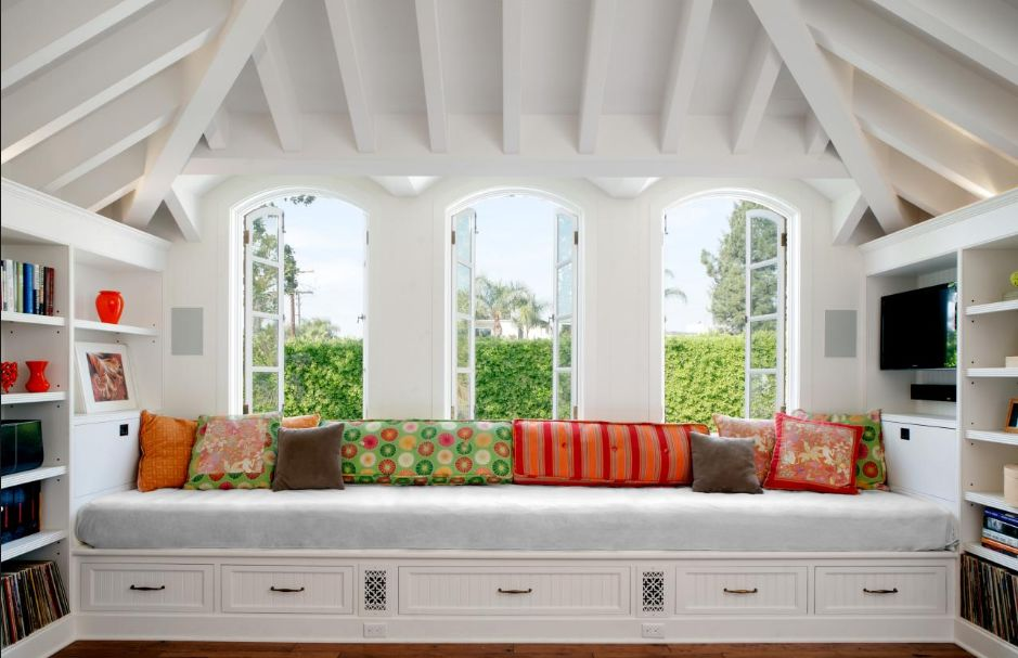 Window seats are a great way to create storage space and they add a very warm and inviting feel to a room.  Who wouldn't like to curl up in this space??  via  HGTV