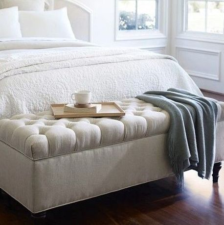 The foot of a bed is a perfect place for a storage bench.  It is surprising how much can be stored in one of these!  via  pinteres t
