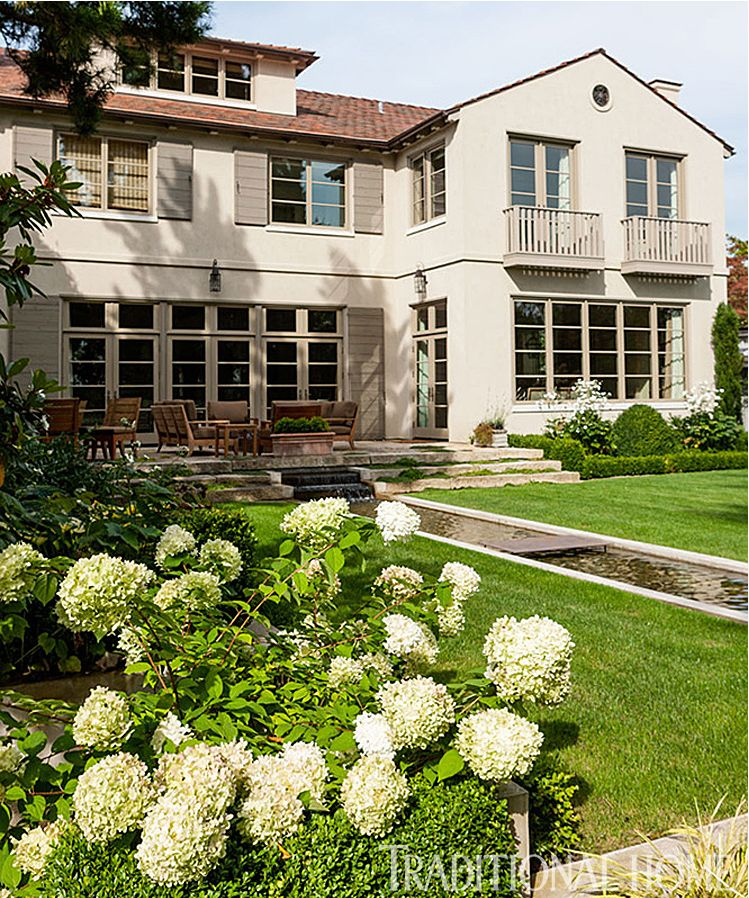 Click on this image of the exterior of their home to see all the photos of this amazing home in Traditional Home, including that bathroom. . .