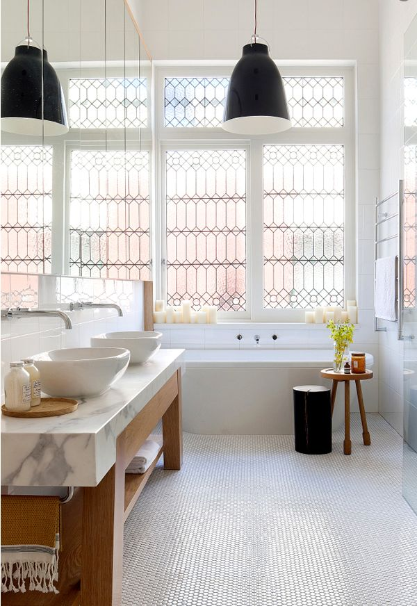 Notice the hotel towel rack on the wall, a small table for extra counter top space, and a tray to hold every day items -more ideas from our previous post! Go to  Studio McGee  to see these 2 photos and more photos of bathrooms.