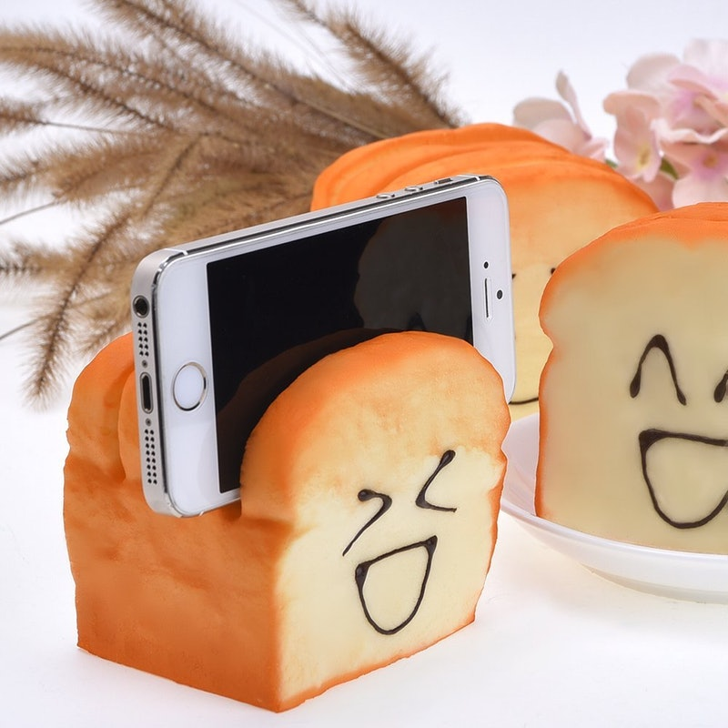 - 3. Squishy Bread Holds Your Phone Outus Squishy Charms toy Bread CellPhone Holder, $6, AmazonTired of having squishy bread on your desk that doesn't hold your phone? Well, you're in luck, pal! This thing does just that! It also makes for an awesome stress ball that springs back into shape after every squeeze. Stop thinking of boobs... It also smells like bread. Whaaaaaaaat!?!