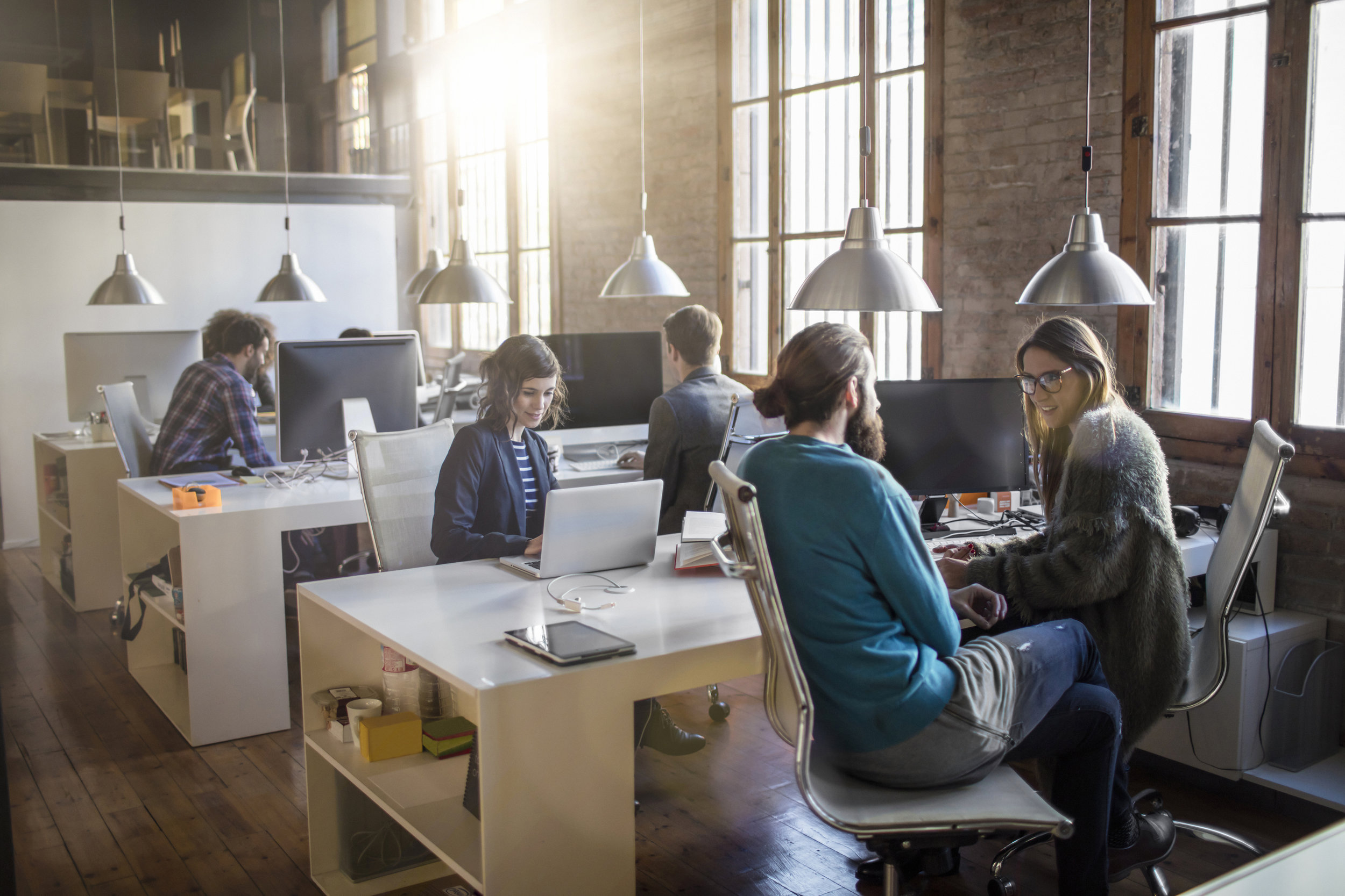 stock-photo-84975537-group-of-young-business-professionals-having-a-meeting.jpg