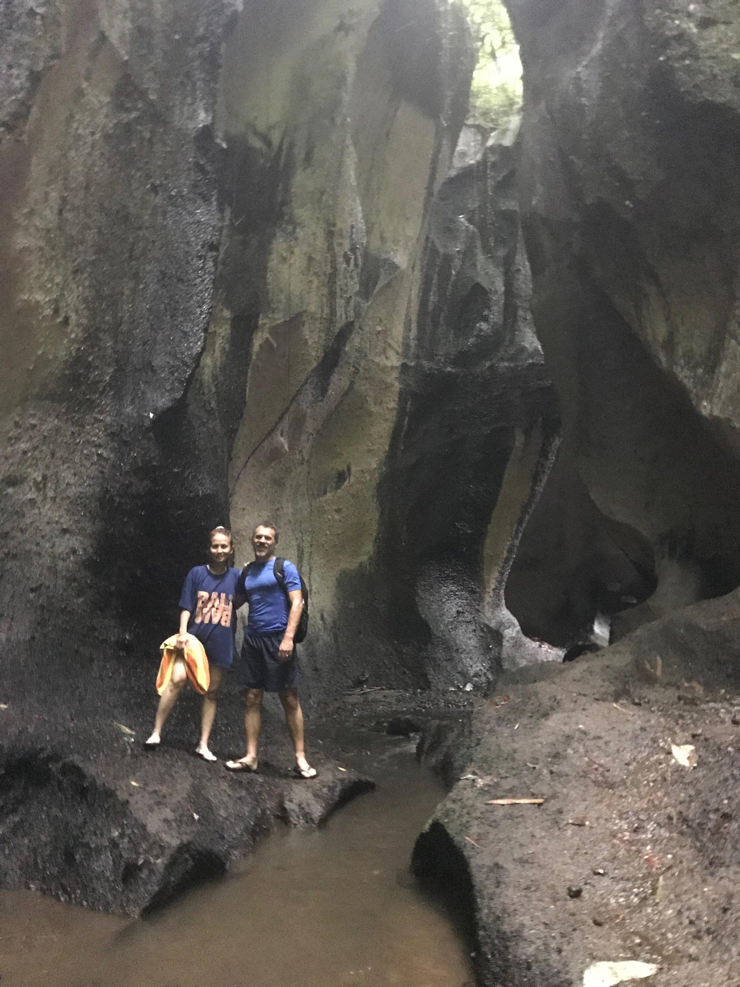 Cave Spelunking towards waterfall.JPEG
