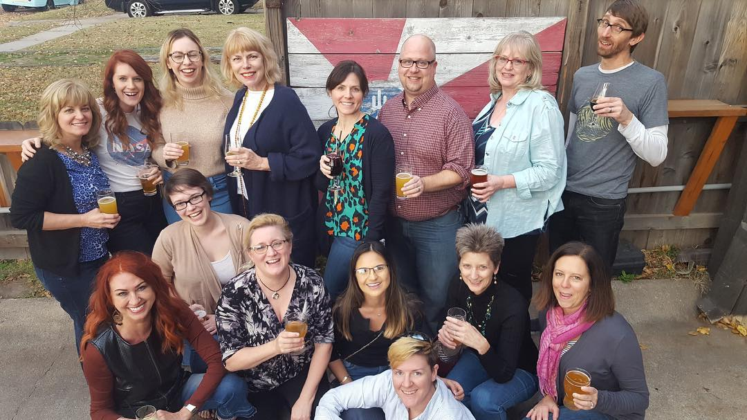 Greteman Group team celebrates the launch of FlightSafety International's website on the patio of Central Standard Brewing