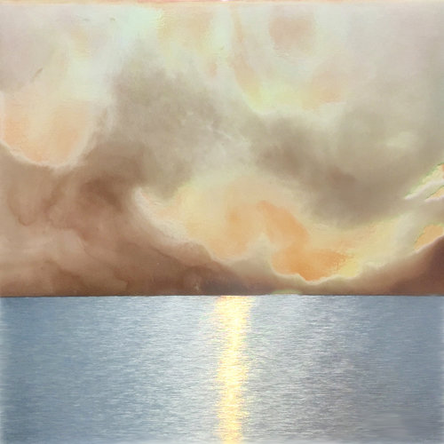 Plum clouds and peach sky hover above a silver sea.